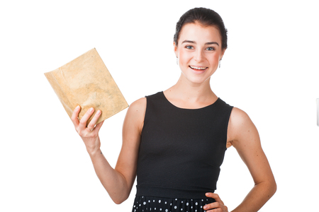 business attire teacher: Smiling pretty girl in elegant dress standing with the opened book, isolated on white background Stock Photo