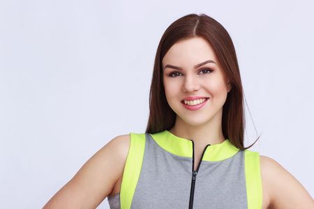 sexual activities: Young lady in grey sportswear on white background