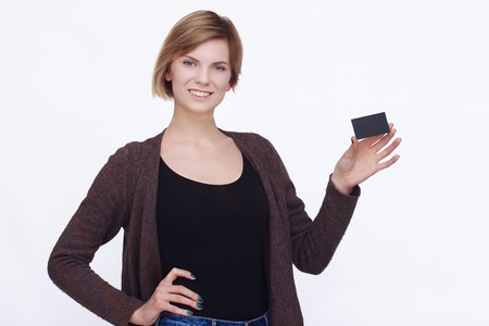 copyspace: Happy woman showing copyspace on isolated background Stock Photo
