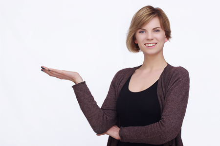 attractive charismatic: Happy woman with palms up on isolated background Stock Photo