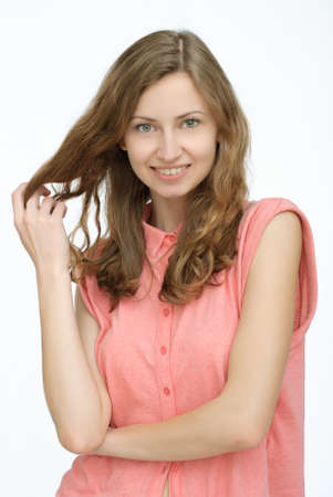 shy woman: Portrait of happy shy woman in shirt on isolated background