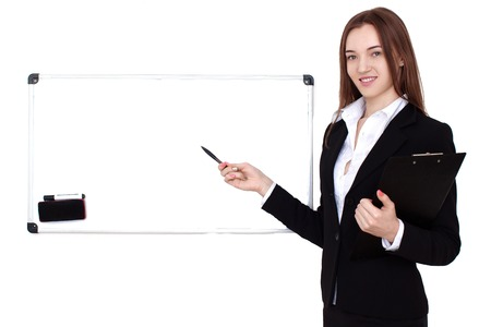 front desk: Portrait of happy businesswoman in front of desk showing something