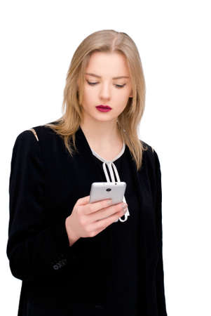 planing: happy confident businesswoman planing something on the mobile cell phone isolated on white
