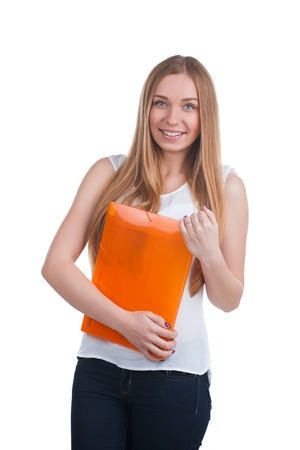 mujer trabajadora: Office worker young blonde woman holds an orange folder over white Foto de archivo