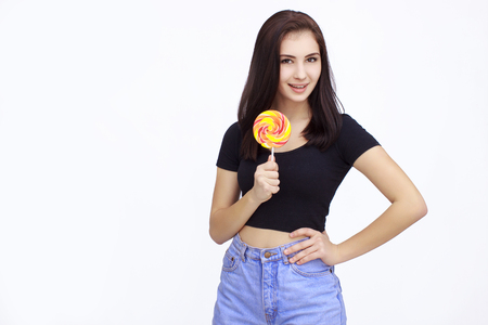 lolipop: Happy Young Woman with lolipop Isolated On White Background