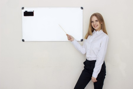 couching: Portrait of coaching woman pointing on board Stock Photo