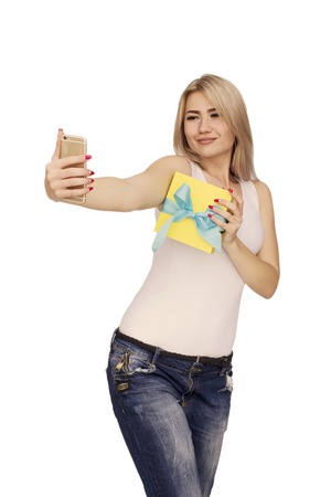 gist: Young happy woman taking selfie on cellphone with gist