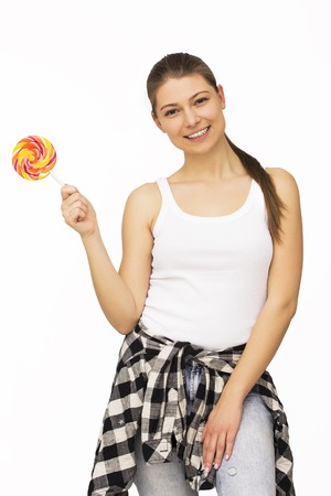lolipop: Happy young woman fooling around, licking lolipop, isolated on white background Stock Photo