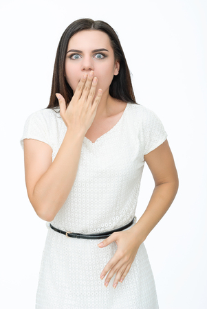 closed mouth: Screaming young woman holding head. Closed mouth