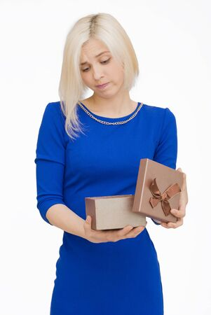 unfortunate: Young woman portrait unfortunate to opening gift Stock Photo