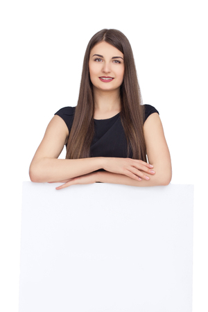 white poster: Advertising. Pretty woman in black dress show blank card or paper on white background.