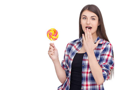 lolipop: Young excited woman holding lolipop on isolated background