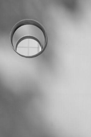 dormer: Grey wall with round dormer window