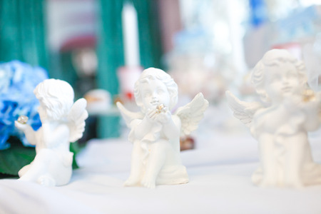 weeping angel: Three statues of angels on the table