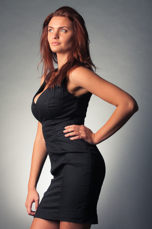 elegance fashion girls look sensuality young: portrait of young beautiful woman in black dress Stock Photo