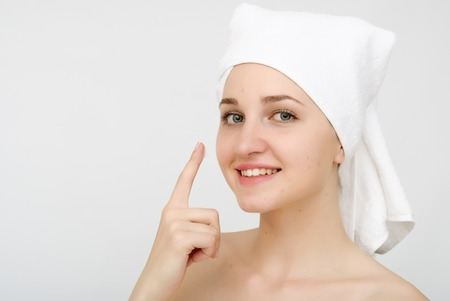 young beautiful woman wrapped in towel