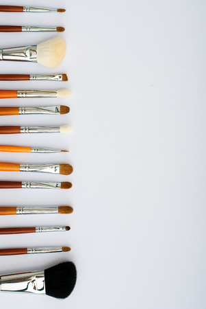 eyemakeup: makeup brush and cosmetics, on a white background