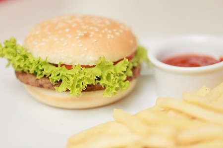 classic burger with French fries on the table in a cafe Stock Photo
