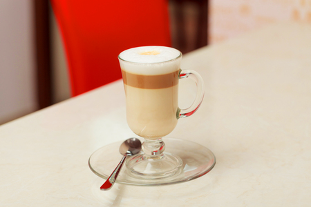coffee latte in glass cup on table Stock Photo