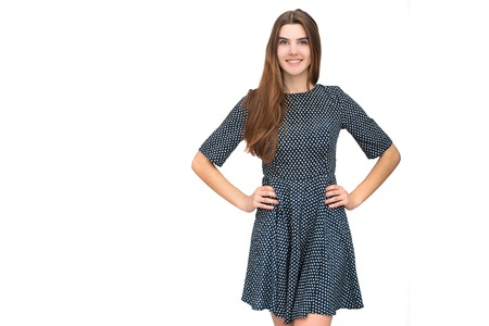 Portrait of young beautiful woman in cute dress isolated on white background. Smiling joyful and happy young girl Stock Photo
