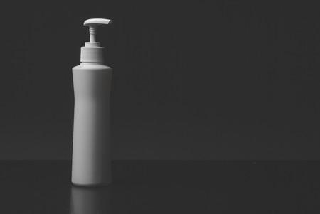 PUMPER: Pumper dispenser of shampoo ,soap baht isolated on black background