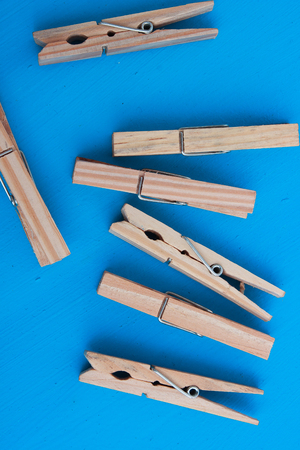 Wooden clothespins on a blue background