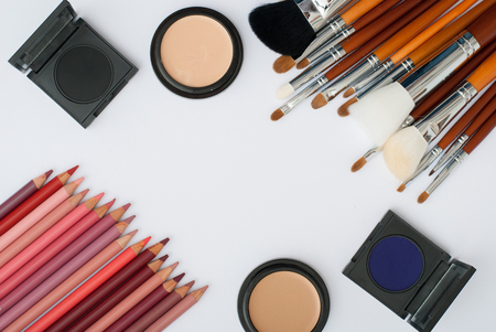 eyemakeup: makeup brush and cosmetics, on a white background isolated