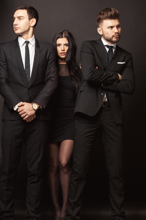 Beautiful female celebrity with bodyguards Stock Photo