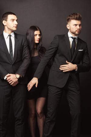 Beautiful female celebrity with bodyguards Stock Photo