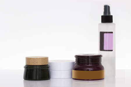 pampering: cosmetic containers isolated