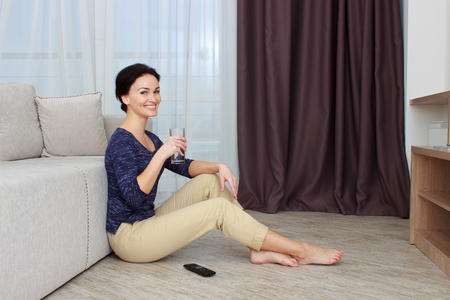 Middle-aged woman in modern home Stock Photo