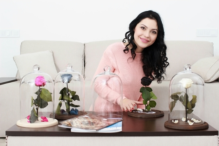 happy girl with rose, received as a gift Stock Photo