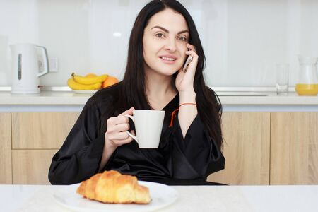 yourself: Young smiling woman having breakfast.Morning ritual Stock Photo