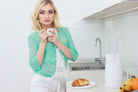 Young smiling woman having breakfast and smiling.Starting your day.Positive energy and emotion.Productivity,happiness,enjoyment concept.Morning ritual