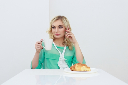 Young smiling woman having breakfast.Morning ritual Stock Photo