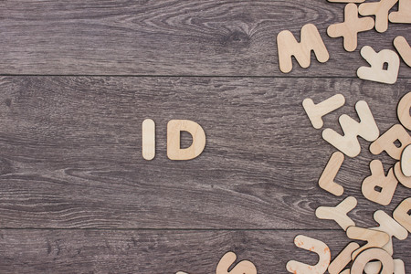 even: Word made with wooden letters next to a pile of other letters over the wooden board