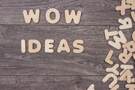 jumbled: Word made with wooden letters next to a pile of other letters over the wooden board