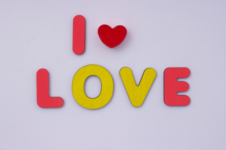Phrase I love you. Words from wooden letters on light grey background. Happy Valentines Day