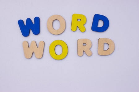 Word World from wooden letters on light grey background.