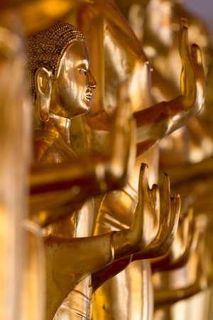many golden image of buddha at wat pho bangkok thailand