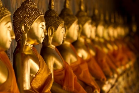 wat: A row of seated Buddhas at the temple of Wat Arun in Bangkok, Thailand