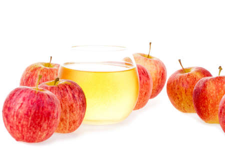 Apple juice in glass and fresh apples on white background  Stock Photo