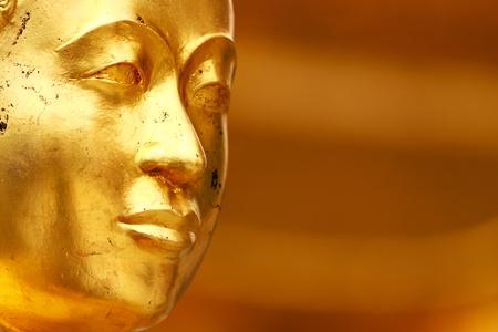 Buddha gold statue close-up