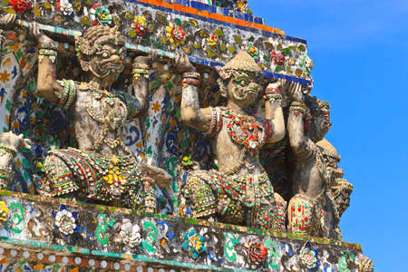 Statue of giant in the temple of Wat Arun, Thailand.  Stock Photo