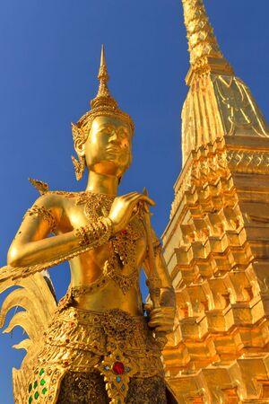Golden Kinnari statue, Bangkok, Thailand photo