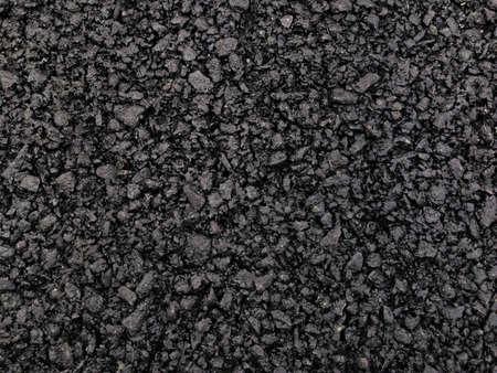 Dark asphalt surface background