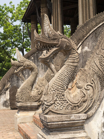 Pagoda Wat Phra Keo in Vientiane, banisters consisting of dragons Stock Photo
