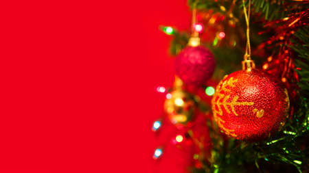 Christmas tree on red background. Stock Photo