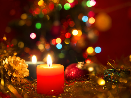 Christmas still life with candle and balls in red tone. Stok Fotoğraf