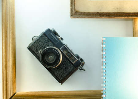 memoirs: Memoirs, diaries, cameras, old frame white background notebook Stock Photo